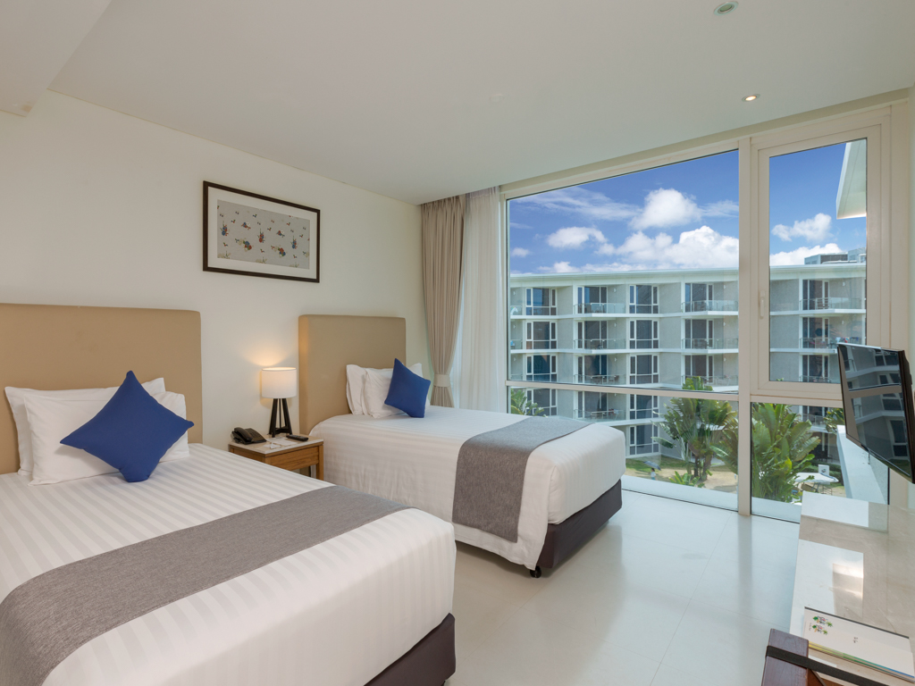 splash beach resort phuket deluxe twin room accommodation with twin size beds